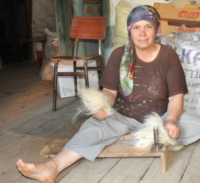 An Anatolian Turkmen lady combing goat hair to make nomadic tent Olukbaşı Village, Bozgoğan, Aydın City, Western Turkey 2016