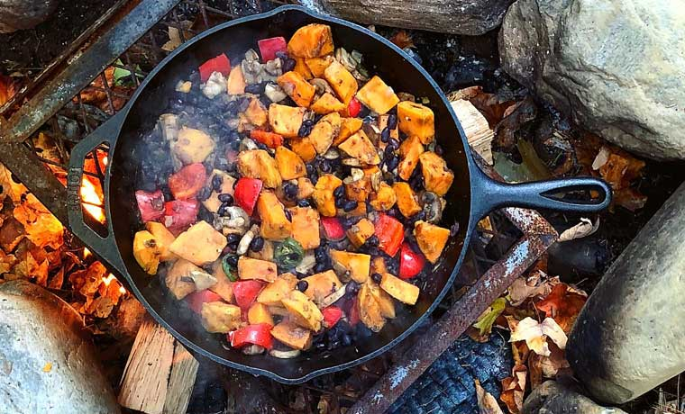 Camp cooking with legumes and potatoes